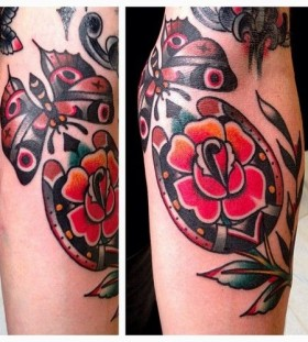 Lovely red flower tattoo by Austin Maples