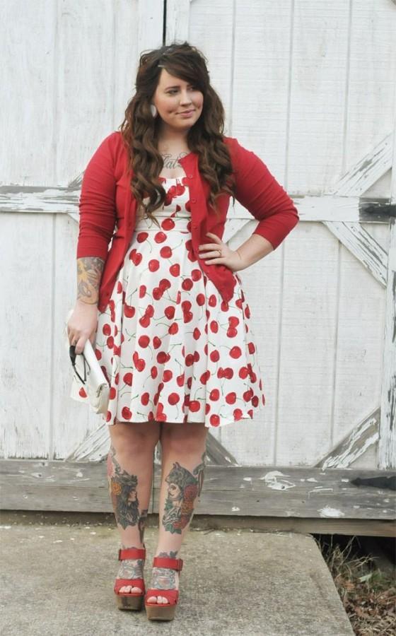 Lovely red women's bee tattoo on leg