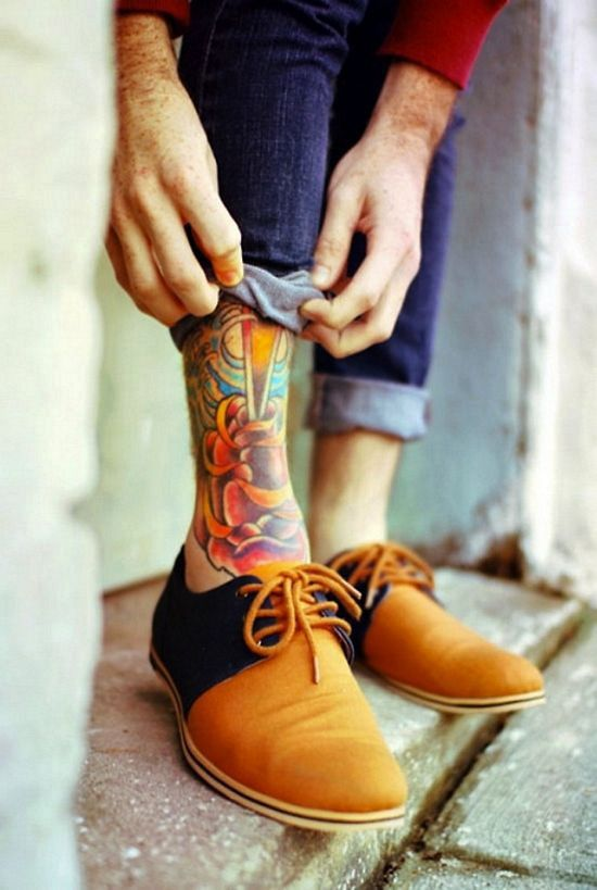 Lovely small tattoo on men's legs