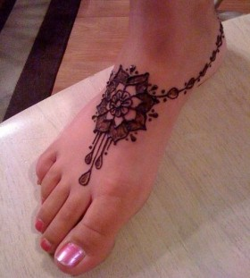 Mandala style foot tattoo
