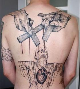 Mens' back cross tattoo