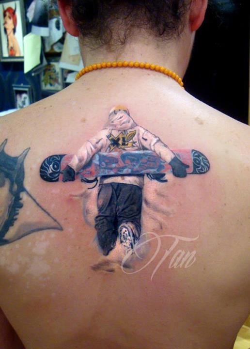 Men's back skiing tattoo