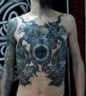 Men's chest black skull tattoo