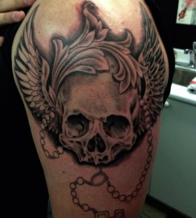 Mens' shoulder skull tattoo