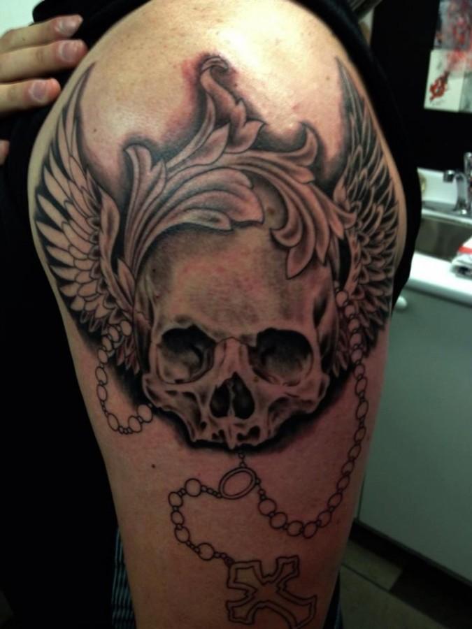 Mens' shoulder skull tattoo