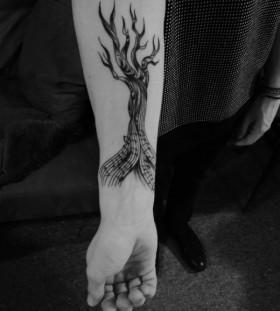 Music style black tree tattoo