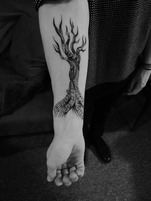 Music style black tree tattoo