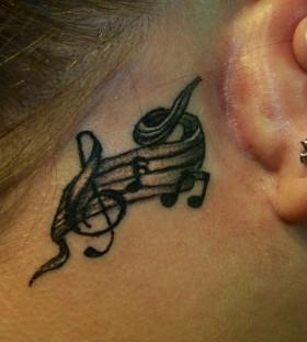 Music stylish girl's ear tattoo