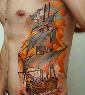 Orange and black ship tattoo