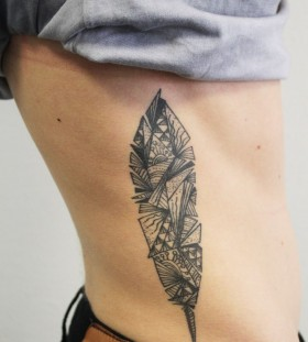 Origami style feather tattoo