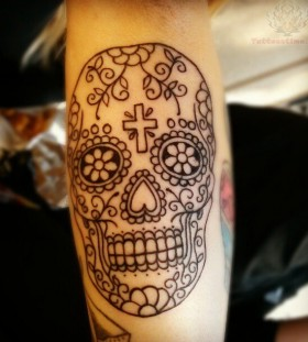 Ornamentally made skull tattoo