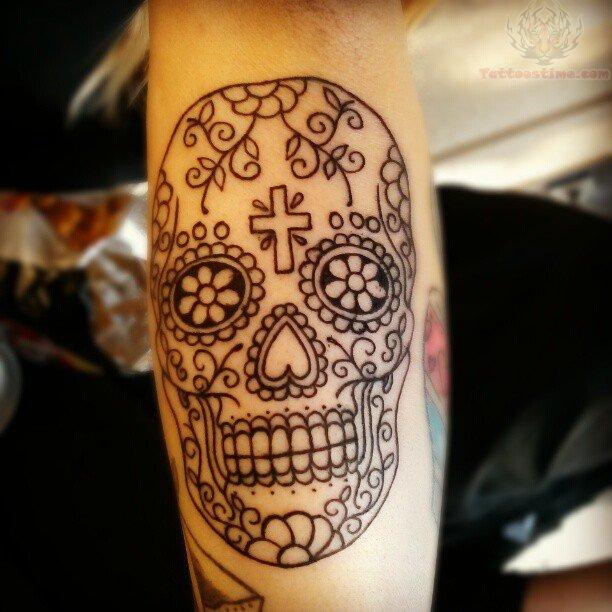 Ornamentally made skull tattoo