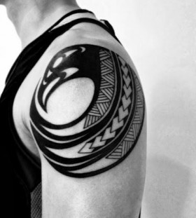Owal black men's arm tattoo