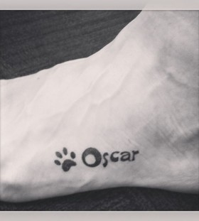 Pawprint Oscar dog tattoo