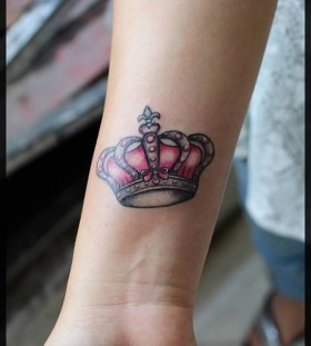 Pink and black crown tattoo