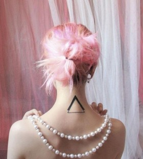 Pink hair girl's geometric style tattoo