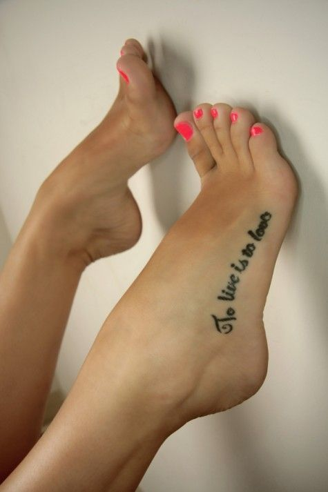 Pink nails and quote tattoo