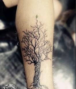 Pretty black tree tattoo