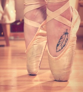 Pretty feather dancer tattoo