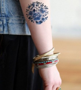 Pretty flower's blue tattoo