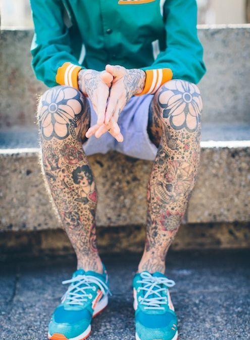 Pretty flowers tattoo on men's legs