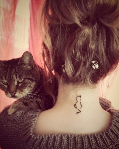 Pretty girl's neck cat tattoo