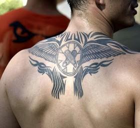 Pretty looking tribal men's back tattoo