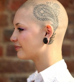 Pretty women's tattoo on head