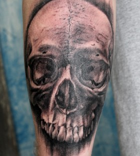 Realistic looking black skull tattoo