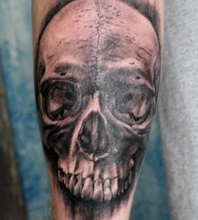 Realistic looking black skull tattoo