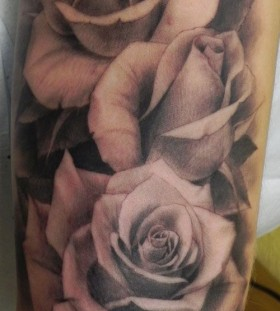 Realistic looking rose tattoo