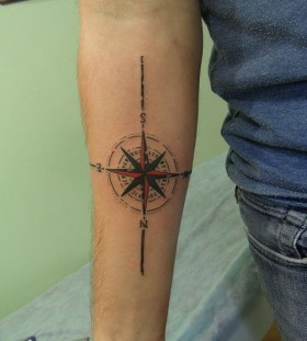 Red and black compass tattoo