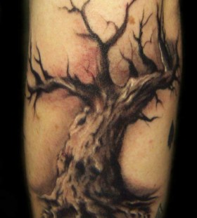 Red and cool black tree tattoo