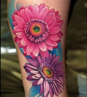 Red and purple cornflower tattoo