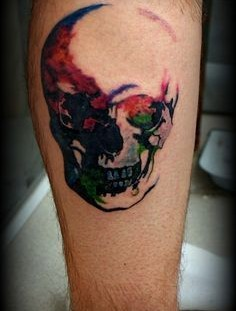 Red, blue and green watercolor skull tattoo