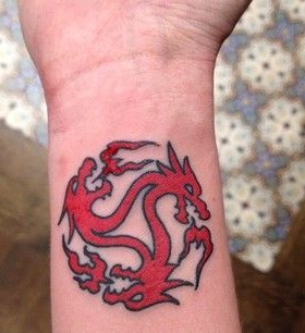 Red dragon's game of thrones tattoo