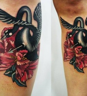 Red flowers and swan tattoo
