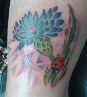 Red ladybird and cornflower tattoo