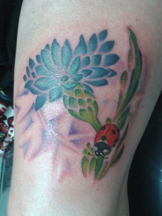Red ladybird and cornflower tattoo