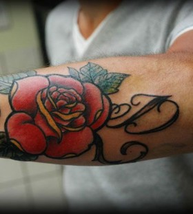 Red letter and rose tattoo