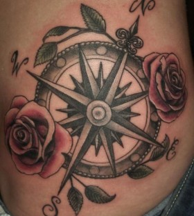 Red lovely roses and compass tattoo