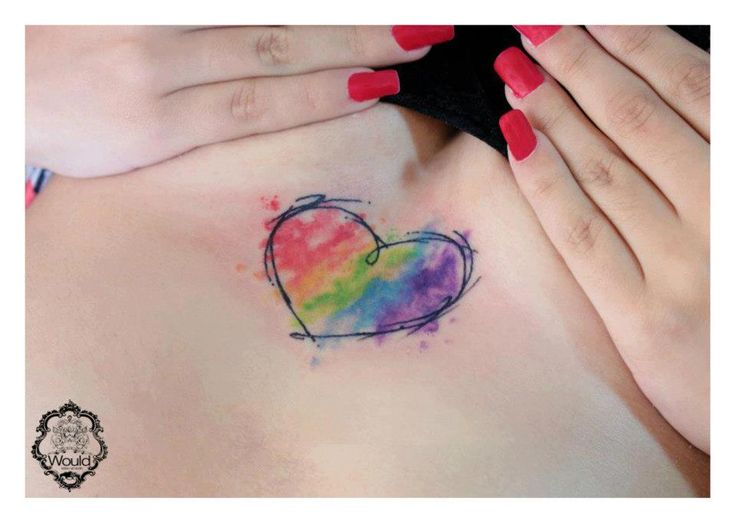 Red nails and heart tattoo by Candelaria Carballo