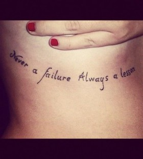 Red nails and quote tattoo