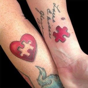 Red puzzles couple tattoo