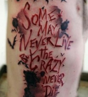 Red quote and batman tattoo