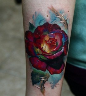 Red realistic rose tattoo