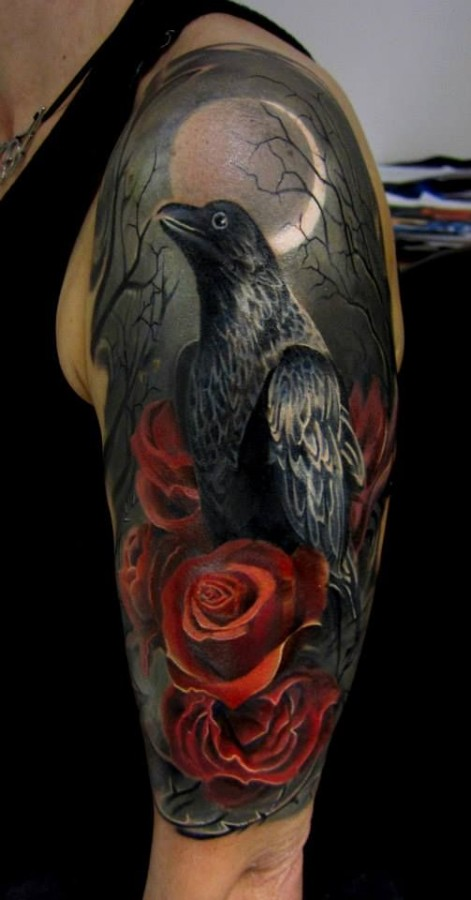 Red roses and eagle tattoo