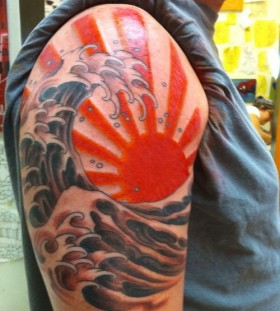 Red sun and wave tattoo