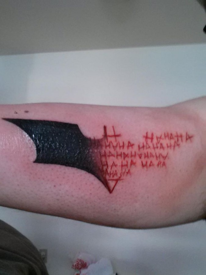 Red symbol of batman tattoo
