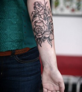 Red t-shirt and flower tattoo